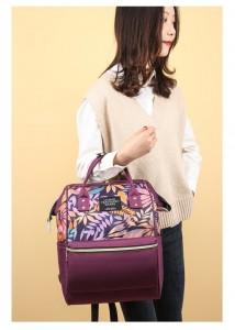 Рюкзак-сумка LIVING TRAVELING SHARE 989-9 фиолетовый в руке у модели