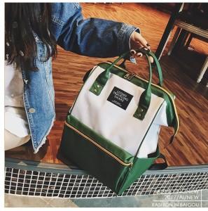 Рюкзак LIVING TRAVELING SHARE 008 бело-зеленый в руке модели