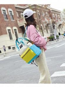 Рюкзак LIVING TRAVELING SHARE 008 бело-желто-голубой на девушке-модели