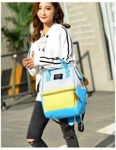 Рюкзак LIVING TRAVELING SHARE 008 бело-желто-голубой на девушке-модели фото 2