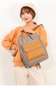 Сумка-рюкзак школьная Fashion 1190 серо-желтая на девушке фото2